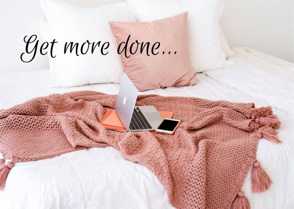 How to avoid distractions and get more focused graphic. Laptop on a blanket on a bed