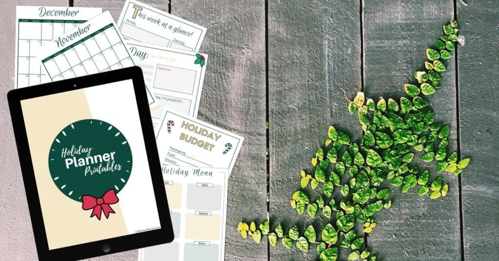 Free Printable Holiday Planner Mockup on Table With Greenery